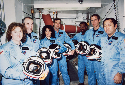 Remembering the Challenger Crew The NASA family lost seven of its own on the morning of Jan. 28, 1986, when a booster engine failed, causing the Shuttle Challenger to break apart just 73 seconds after launch.  In this photo from Jan. 9, 1986, the Challenger crew takes a break during countdown training at NASA's Kennedy Space Center. Left to right are Teacher-in-Space payload specialist Sharon Christa McAuliffe; payload specialist Gregory Jarvis; and astronauts Judith A. Resnik, mission specialist; Francis R. (Dick) Scobee, mission commander; Ronald E. McNair, mission specialist; Mike J. Smith, pilot; and Ellison S. Onizuka, mission specialist. Image Credit: NASA