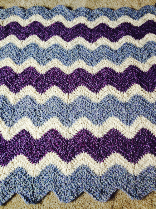 I'm almost finished with my dads best friend's ripple afghan. It matches all of the colors in her home :)