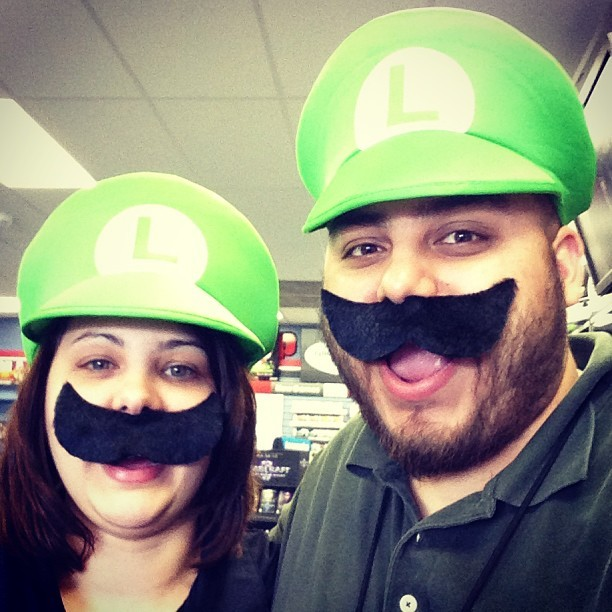 Danielle and I are enjoying these Luigi hats a little too much. #Luigi #selfie #nintendo