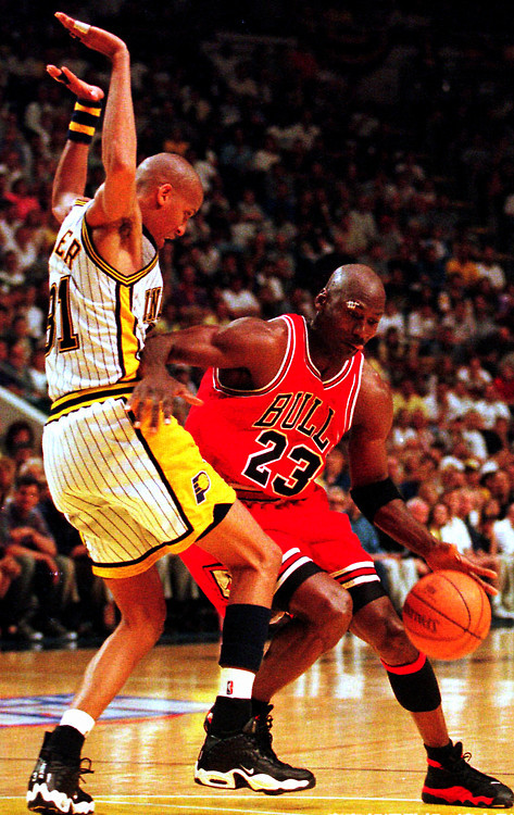 phuckindope:  Michael Jordan in Bred 13s