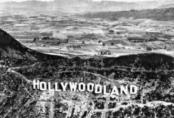 losangelespast:  The Hollywoodland sign on Mt. Lee, with the San Fernando Valley in the background, 1920's.   The land…