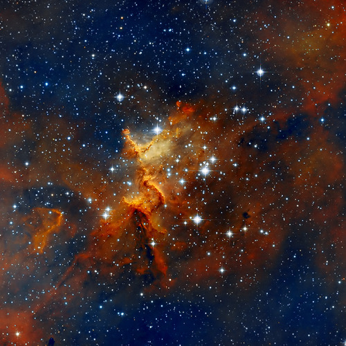 scinerds:  Melotte 15: Open Cluster in Cassiopeia  The Heart of Heart Nebula - IC1805 This is the H-HO-O bicolor combination. Melotte 15 is a very loose open cluster in the central regions of emission nebula IC 1805 (Heart Nebula) located about 7500 light years away. It is catalogued by the British-Belgian astronomer Philibert Jacques Melotte (1880-1961). This open cluster is about 1.5 million years young and contains a few bright stars nearly 50 times the mass of our Sun, and many more dim stars that are only a fraction of our Sun's mass. — Velimir Popov