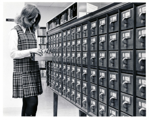"""A student using the card catalogue at the David O. McKay Library at BYU-Idaho."""