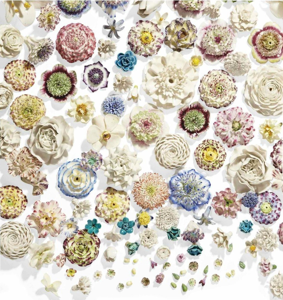 A collection of porcelain flowers in the classic Louis XV Sevres style via Christies