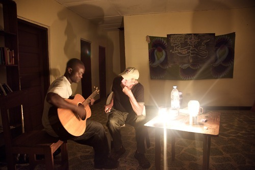 Sharing music by lamplight in Liberia