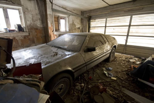 fuckyeahabandonedplaces:  An abandoned DeLorean as found in a New Jersey garage in 2008. It's been rescued.