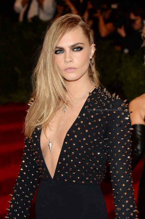 thecaradelevingne:  at the Costume Institute Gala for the PUNK: Chaos to Couture wearing Burberry and JFisher Jewellery!  If I could change my style….