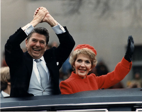 Ronald and Nancy Reagan waving from the limousine during the Inaugural Parade. Washington , DC. 1/20/81 .