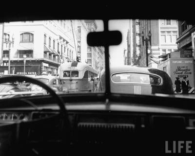 bygoneamericana:  Traveling through rush hour traffic in downtown Los Angeles, 1949. By Loomis Dean