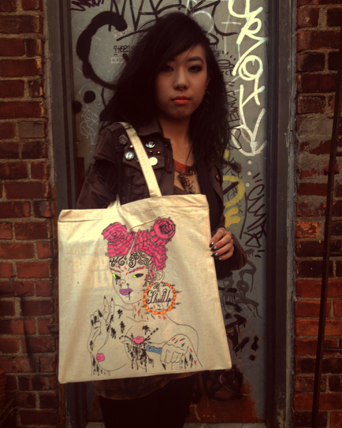 SILKSCREENED AND HAND COLORED SHUT UP GIRL TOTE BAGS ARE FOR SALE ON MY BIGCARTEL!! LIMITED EDITION OF 30! perfect size for records, as you can probably see from the buddy holly record peeking thru .. http://heatherbenjamin.bigcartel.com/ MODELED BY TIFF JET NG