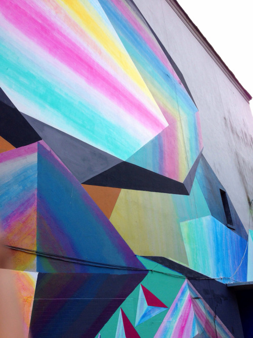 havte:  'protein lite' mural paintings by josef kristofoletti  austin-based artist josef kristoletti just finished 'protein lite' — his latest piece in panama city — rendering colorful three-dimensional looking prisms. the mural was painted for the first biennial of the south in panama 2013, an international project that invites artists from around the world to use street art and public interventions for the promotion of contemporary art in the urban culture and public environment of the central american region.