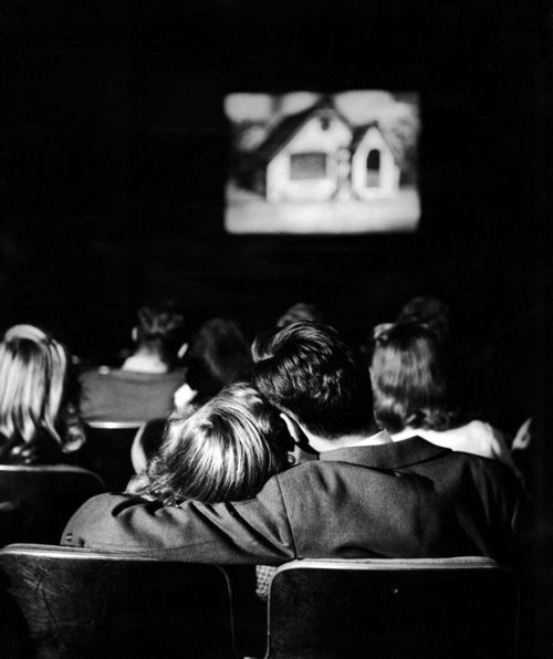 onlyoldphotography:  Nina Leen: Teenagers necking in a movie theater. 1944