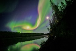 "ikenbot:  VISIONS: NASA Plans To See the Aurora In A New Light     On a cold February night in Poker Flat, Alaska, a team of scientists will wait patiently for the exotic red and green glow of an aurora to illuminate the sky. Instead of simply admiring the view, this group from NASA's Goddard Space Flight Center of Greenbelt, Md., and The Aerospace Corporation of El Segundo, Calif. will launch a sounding rocket up through the Northern Lights. The rocket could launch as early as the night of Feb. 2, 2013, but the team has a two-week window in order to find the perfect launch conditions.      Image: Swirls of green and red appear in an aurora over Whitehorse, Yukon on the night of Sep. 3, 2012. NASA's VISIONS sounding rocket will study what makes the aurora, and how it affects Earth's atmosphere. Image Courtesy of David Cartier, Sr.      Armed with a series of instruments developed specifically for this mission, the VISIONS (VISualizing Ion Outflow via Neutral atom imaging during a Substorm) rocket will soar high through the arctic sky to study the auroral wind, which is a strong but intermittent stream of oxygen atoms from Earth's atmosphere into outer space. Although the rocket will survive only fifteen minutes before splashing down in the Arctic Ocean, the information it obtains will provide answers to some long-standing questions, says Doug Rowland, who is the VISIONS principal investigator at Goddard.      VISIONS will study how oxygen atoms leave Earth's atmosphere under the influence of the aurora. Most of the atmosphere is bound by Earth's gravity, but a small portion of it gets heated enough by the aurora that it can break free, flowing outwards until it reaches near-Earth space. The atoms that form this wind initially travel at about 300 miles per hour — only one percent of the speed needed to overcome gravity and leave Earth's atmosphere.      ""This oxygen would normally never gain enough energy to leave the atmosphere,"" says Rowland. ""On the other hand, at very high altitudes, satellite experiments have measured oxygen atoms moving faster than 50 miles per second. These experiments have shown that if oxygen can reach these high altitudes, there are plenty of ways for it to gain even more energy, in which case the oxygen atoms can escape near-Earth space entirely. What we don't know is how the oxygen gets enough energy to fight against gravity and reach the higher altitudes where these slingshots are active."""