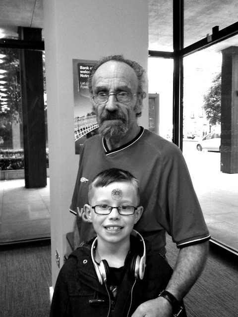 renascible:  Father & son, black and white. Portrait of strangers.