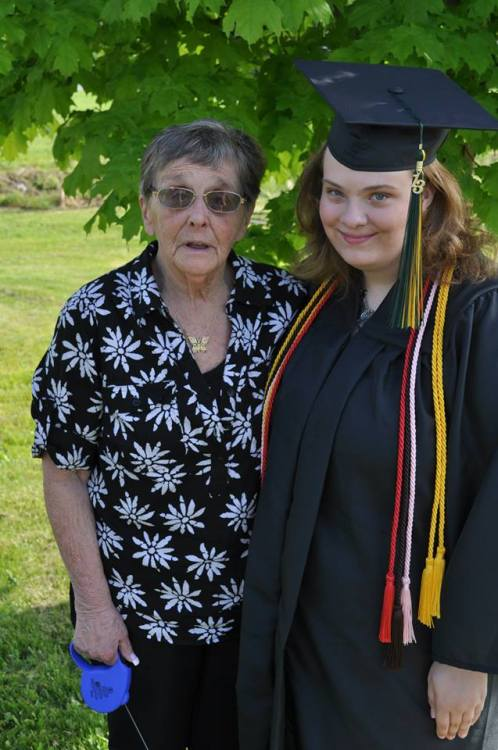 My grandmother and I after graduation. Now you guys know what the weirdo you follow looks like.