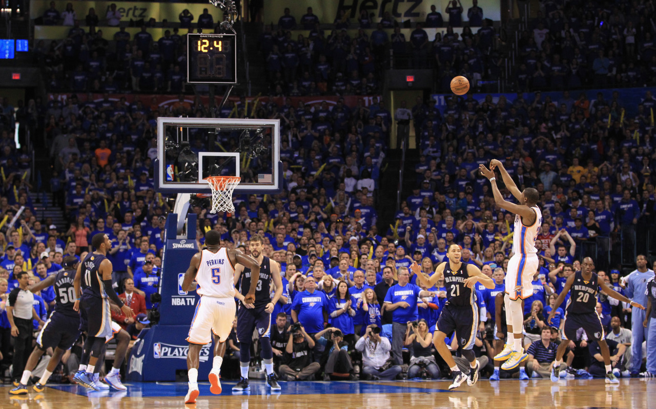 nba:   Kevin Durant  of the Oklahoma City Thunder makes a two-point shot with 12.6 seconds left against the Memphis Grizzlies during Game One of the Western Conference Semifinals of the 2013 NBA Playoffs at Chesapeake Energy Arena on May 5, 2013 in Oklahoma City, Oklahoma. The Thunder defeated the Grizzlies 93-91. (Photo by Ronald Martinez/Getty Images)