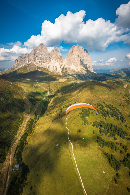 visitheworld:  Paraglider in front of the Langkofel group of the Dolomites, Italy (by Alexandre Buisse).