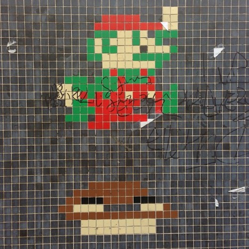 laughingsquid:  8-bit Super Mario Bros tile art found on the streets of Paris.