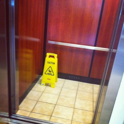 Why does the Floor Caution sign in the Elevator tickle me so? (at Microtel Inn & Suites Houma)