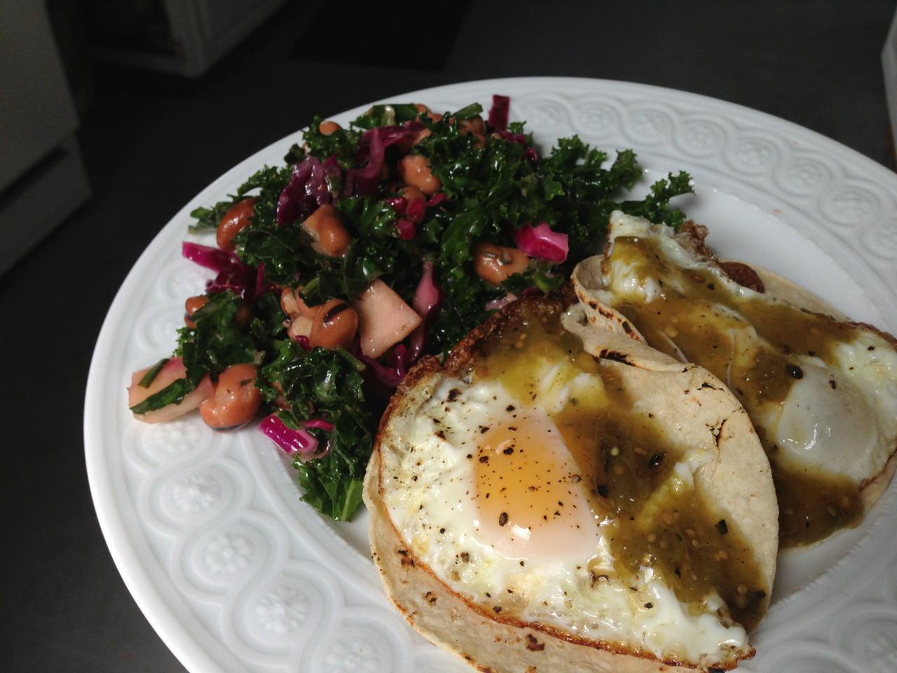 Fried egg tacos, roasted tomatillo salsa, kale and braised fava bean salad