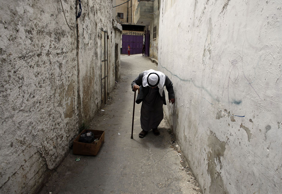 "fotojournalismus:  Taha Abu Latife, a 95-year-old Palestinian refugee who says he was forced to flee his village in 1948 and now lives in Qalandiya Refugee Camp near the West Bank city of Ramallah, walks home ahead of Nakba Day on May 13, 2013. Palestinians will mark ""Nakba"" (Catastrophe) on May 15 to commemorate the expulsion or fleeing of some 700, 000 Palestinians from their homes in the war that led to the founding of Israel in 1948. [Credit : Ammar Awad/Reuters]"