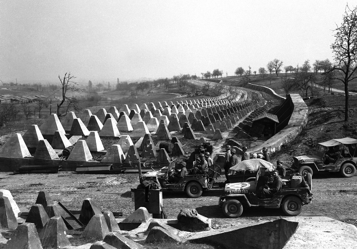 Men of the American 7th Army pour through a breach in the Siegfried Line defenses, on their way to Karlsruhe, Germany on March 27, 1945, which lies on the road to Stuttgart. (AP Photo)