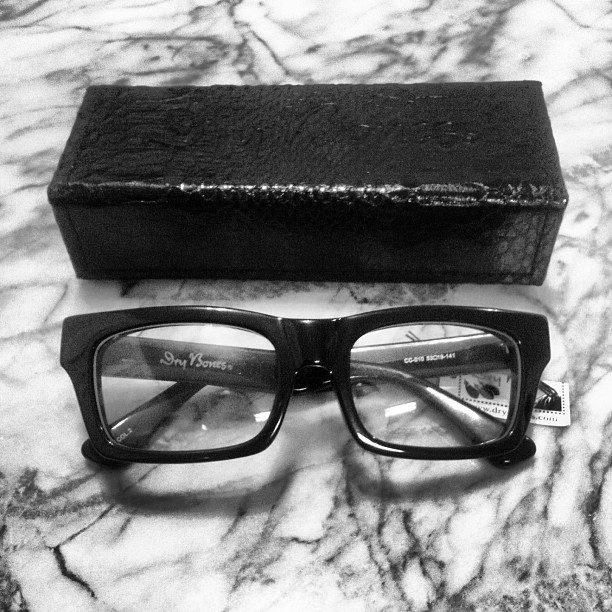 Finally, new eyeglass frames. My Gellers have seen better days. Dry Bones Japan angular bone glasses with an awesome snakeskin case. Via Self Edge NY