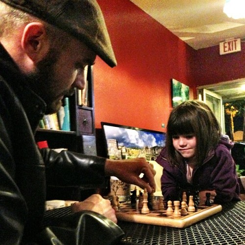My #daughter and I playing #chess at an #artwalk in #northpark this weekend. Or maybe it was #southpark, I don't know all those neighborhoods bleed together. She picked up on the piece movements pretty quickly, just need to get her to start planning her moves. ———————————————— ———————————————— #daddydaughtertime #coffeeshop #art #night #sandiego #igerssandiego #california_igers #igerscalifornia #iphonesia #iphoneonly #jj #jj_forum #weird #Photooftheday #imageoftheday #mobilephotography #igers #iger #instahub #instagood #instagramhub #igerssandiego