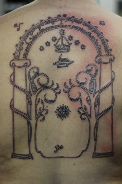 fuckyeahtattoos:  Durin's Door, also called The Gates of Moria, from Lord of the Rings. It's still a little red, because it was just finished. Done by Eric Calrk at Empire Tattoo in Fenton, Michigan.