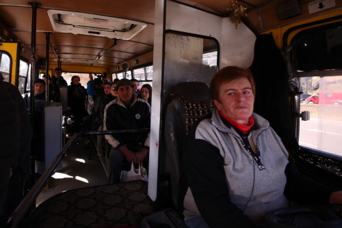 "humansoftbilisi:  ""I've been a tram conductor, a taxi driver, and a bus driver since I was 22,"" she said. ""Has it been tough?"" I asked. ""I've seen surprised faces and I've heard insults. Being friendly, calm and keeping distant has helped me through it,"" she explained. ""Tell me your love story,"" I asked. ""Oh. I don't want to remember it,"" she replied."