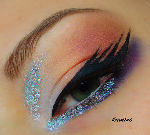 Love this glitter and multi-winged liner look by Kinga C.!