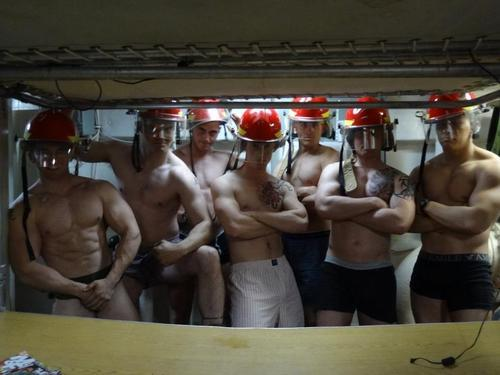 Group of firefighter males stripped down to their undies.