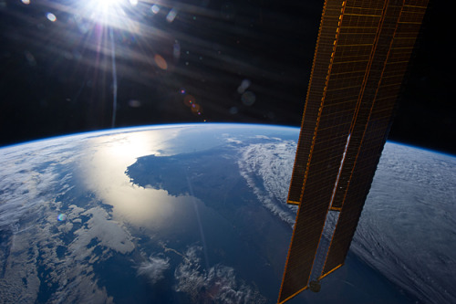 distant-traveller:  Australia as seen from orbit  The sun is about to set in this scene showing parts of southwestern Australia, which was photographed by one of the Expedition 35 crew members aboard the International Space Station on April 1, 2013.  Image credit: NASA