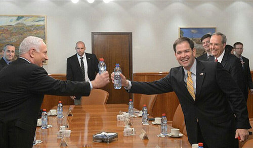 "U.S. Senator Marco Rubio reaches for a water bottle along with Israeli Prime Minister Benjamin ""Bibi"" Netanyahu."