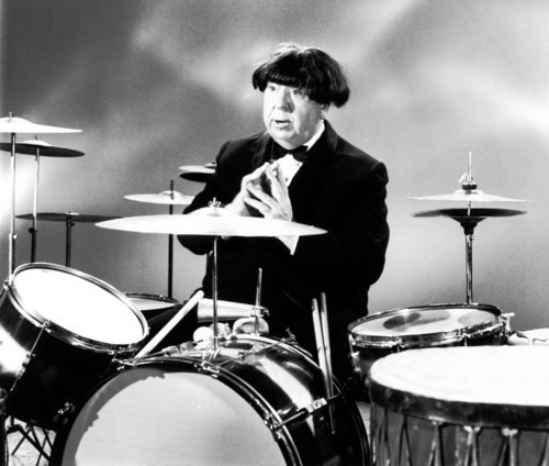 Hitchcock wearing a Beatles wig.
