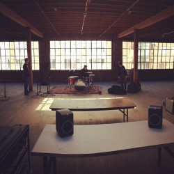 Setting up for gold bears drums.  (at MASS Collective)