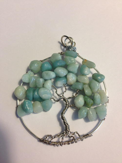 I ordered this Tree of Life pendant from Unique Visions by Jen https://www.etsy.com/transaction/114730689 It's perfect!!  It's not gaudy or overwhelmed by the stone chips, the tree structure is visible and beautiful!  The wire wrapping is amazing, it doesn't come unwound or poke you!! Which is common among wire wrapped jewelry.  I absolutely love this piece ^_^  Thank you Jen!
