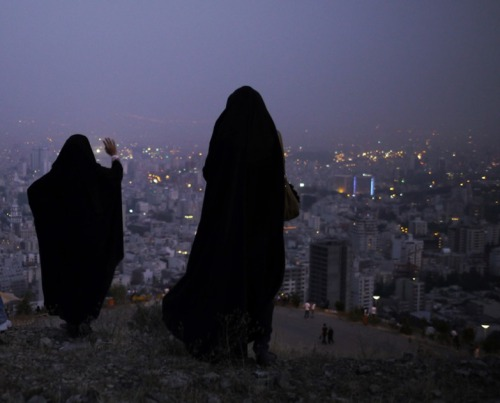 losed:  Women in the hills above Tehran at dusk (© Amos Chapple) via The Atlantic