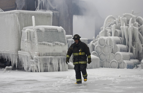 reuters:  Chicago Fire Department Lieutenant Charley De Jesus walks around an ice-covered warehouse that caught fire Tuesday night in Chicago January 23, 2013.  Fire department officials said it is the biggest fire the department has had to battle in years and one-third of all Chicago firefighters were on the scene at one point or another trying to put out the flames.  An Arctic blast continues to gripped the U.S. Midwest and Northeast Wednesday, with at least three deaths linked to the frigid weather, and fierce winds made some locations feel as cold as 50 degrees below zero Fahrenheit. [REUTERS/John Gress] READ ON: Arctic blast grips U.S., likely to last for days  I wish you would send a bit of that cold down here… (not all of it, just a little bit)… It's ridiculous that it's 72 degrees right now… and it's likely to warm up to 80 this week.