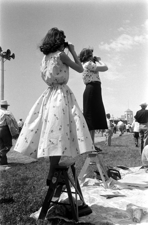 life:  Not published in LIFE. Spectators watch a race at Churchill Downs on Derby day, 1955 — see more photos from the '55 Kentucky Derby here. (John Dominis—Time & Life Pictures/Getty Images)
