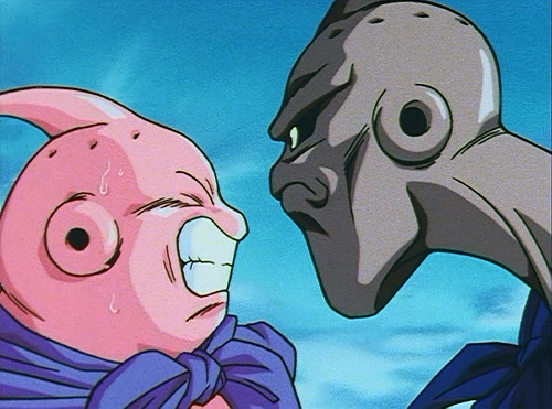 Dragon Ball Z - Episode 255 - Buu and Evil Buu locked in an intense competitive stare.