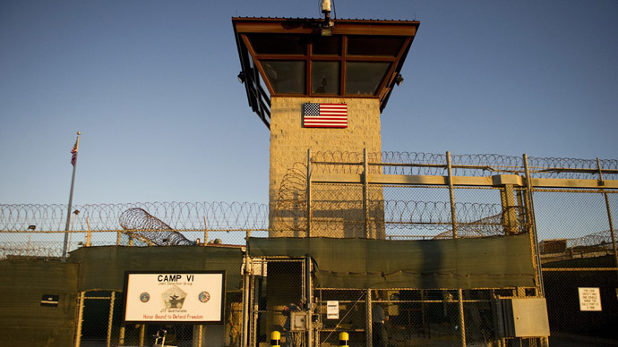 "Gitmo Hunger Strike: 'Prisoners put their lives on the line in a medieval torture chamber' | RT March 17, 2013 An inmate hunger strike at Guantanamo prison has entered its 40th day, with more than 100 reportedly taking part. Experts warn of health risks over a strike prompted by the confiscation of prisoners' belongings and rough handling of Korans. The prisoners' lawyers, along with other experts and former detainees, are sounding the alarm over the inmates' critical condition. ""They are indeed threatening their own lives, putting their lives on the line in this heroic effort to express a sense of autonomy, outrage at being imprisoned in what can be characterized as nothing less than the American sort of medieval torture chamber,"" anthropologist Mark Mason, who studies the cultural factors behind human suffering, told RT. ""We have here conditions where 166 people are imprisoned, more of half of them cleared, they should be out to the streets, free today,"" Mason added. ""I frankly cannot describe some of the horrific conditions and treatment and humiliation that many detainees have reported. They have been stripped and required to stand around in cold rooms for hours naked. This is itself a physical stressor, but it is almost unspeakable psychological torture."" ""We are humans, we are not eagles in a bag of skin, we relate to each other, we need human contact and relationships to be healthy psychologically and physically,"" he said. Mason claimed that the US lives in a ""distortion zone,"" where ""people imprisoned in Guantanamo should be free while the president, our former president, vice president and bankers in the US and Wall Street should be in jail."" US President Barack Obama began his first term by announcing his intention to close the Guantanamo Bay detention center. Now, just two months into his second term, the prison has entered its 12th year of operation with 166 detainees still languishing behind bars and a reported 130 on a life-threatening hunger strike. 9- to 12-year-old kids detained and tortured in Guantanamo? Former Guantanamo detainee Murat Kurnaz described to RT the horrible conditions he faced while being detained there, and explained the reasons behind the hunger strike. ""I have been tortured in different kinds of ways. There are no human rights over there. That means they could do whatever they wanted to with us,"" Kurnaz said. ""They tortured me to force me to sign papers and every time I've refused, they kept on torturing me in different kind of ways."" ""They really tried everything to break us including psychological and physical torture. I myself got tortured by electroshocks and waterboarding. I have seen also kids 9 years and 12 years old inside the camp. It was very difficult to watch how those kids getting beaten up in front of me,"" he added. Kurnaz argued that detainees have ""many justified reasons"" to go on a hunger strike:""It is a bad situation, prisoners want to go to court and want their rights back. They don't have the opportunity to go to the court or see their families. They do not have the right to write or receive letters."" The state of legal limbo was also frustrating for Kurnaz, who was determined to be innocent by the US but had to spend an extra five years in detention because Germany refused to take him back. ""Their hunger strikes are the only way they have of making themselves heard. Years and years without any hope of release. Without any real charges,"" political writer and activist Sara Flounders told RT. Lawyers for the Guantanamo prisoners said the men began the hunger strike on February 6 in protest against the alleged confiscation of personal items such as photographs and personal mail, as well as the alleged sacrilegious handling of their Korans during searches of their cells. The Center for Constitutional Rights said that they have received reports of detainees coughing up blood, losing consciousness, losing more than twenty pounds of weight and being hospitalized. Medical experts have predicted that by the 45th day of a hunger strike, participants can experience hearing loss and potential blindness – on top of the psychological suffering they have endured for more than a decade. The UN issued a statement this week that the US is violating international human rights law by holding detainees indefinitely and without charge. Copyright © 2013 Autonomous Nonprofit Organization ""TV-Novosti"". [Photo: This image reviewed by the US military shows the front gate of ""Camp Six"" detention facility of the Joint Detention Group at the US Naval Station in Guantanamo Bay, Cuba. (© AFP Photo/Jim Watson)]"