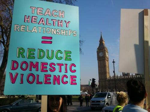 "girlsgetbusyzine:  ""Teach healthy relationships = Reduce domestic violence"" protest sign"