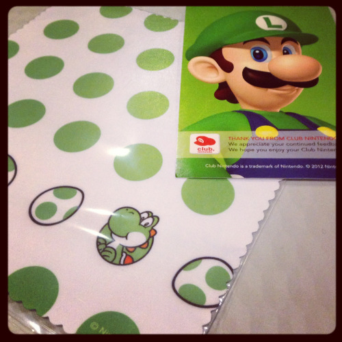 Got me a Yoshi cleaning cloth from Club Nintendo! I love this thing but don't want to use it much and get it all dirty. Meh!