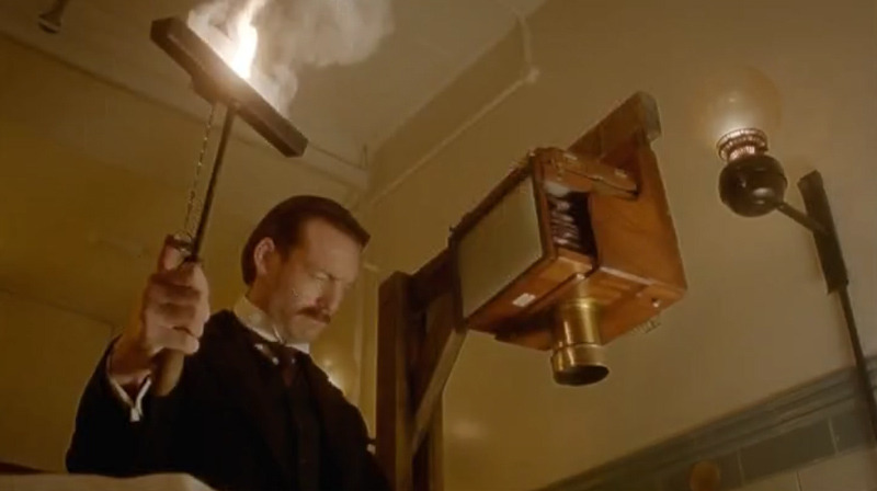 "Another look at that copy camera in Doctor Who ""The Crimson Horror"" (2013). A really interesting camera; evidently a whole plate copy camera. What I can't quite work out is the panel on the side. Is it a a ground glass? Reflex focussing perhaps? It would be useful in a camera mounted in this manner."