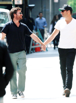 Jason and Will holding hands while walking thru NY.