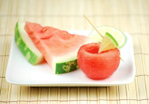 partyrehabbrecipes:  Watermelon Margarita Shots / Watermelon Shot Glasses.Ingredients & Measurements: 12 Watermelon Shot Glasses (See Below) 1 1/2 oz. Tequila 1/2 oz. Triple Sec 1 oz. Sweet & Sour Mix 1 small Watermelon Slice 1/4 Lime Ice Instructions:Cut watermelon off of the rind and place into shaker with lime. Muddle. Add tequila, triple sec, and sweet and sour mix. Shake with ice. STrain into measuring cup and pour into watermelon shot glasses.How To Make Watermelon Shot Glasses:Scoop out watermelon balls with a 1 1/2 inch ice cream scooper. Cut a small slice off the bottom. Use a mellon baller to scoop the insides out from the top, be careful so you don't puncture.