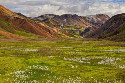 Landmannalaugar (the people's pools) is a hiking hub in Iceland's highlands and has popular natural geothermal hot springs. The area displays a number of unusual geological elements, like the multicolored rhyolite mountains and expansive lava fields. Add it to your list at www.tripbucket.com