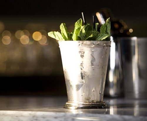 Mint Julep  Today's the Kentucky Derby, and in keeping with tradition we're drinking Mint Juleps. Muddle some mint and sugar, crush some ice and pour some Kentucky Bourbon. Make sure it's Bourbon, and make sure it's from Kentucky. Enjoy!