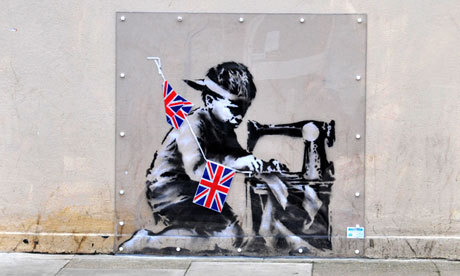 A Banksy mural has been put up for auction on a US website with a guide price of up to £450,000 after being removed from a building in north London. Photograph: The graffiti, titled 'Banksy Slave Labor (Bunting Boy). London 2012', as it was on the side of Poundland store in Wood Green, London. Matthew Chattle/Alamy (via Banksy mural torn off London Poundland store for Miami auction | Art and design | guardian.co.uk)